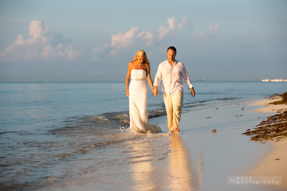 Walking along the shore holding hands.