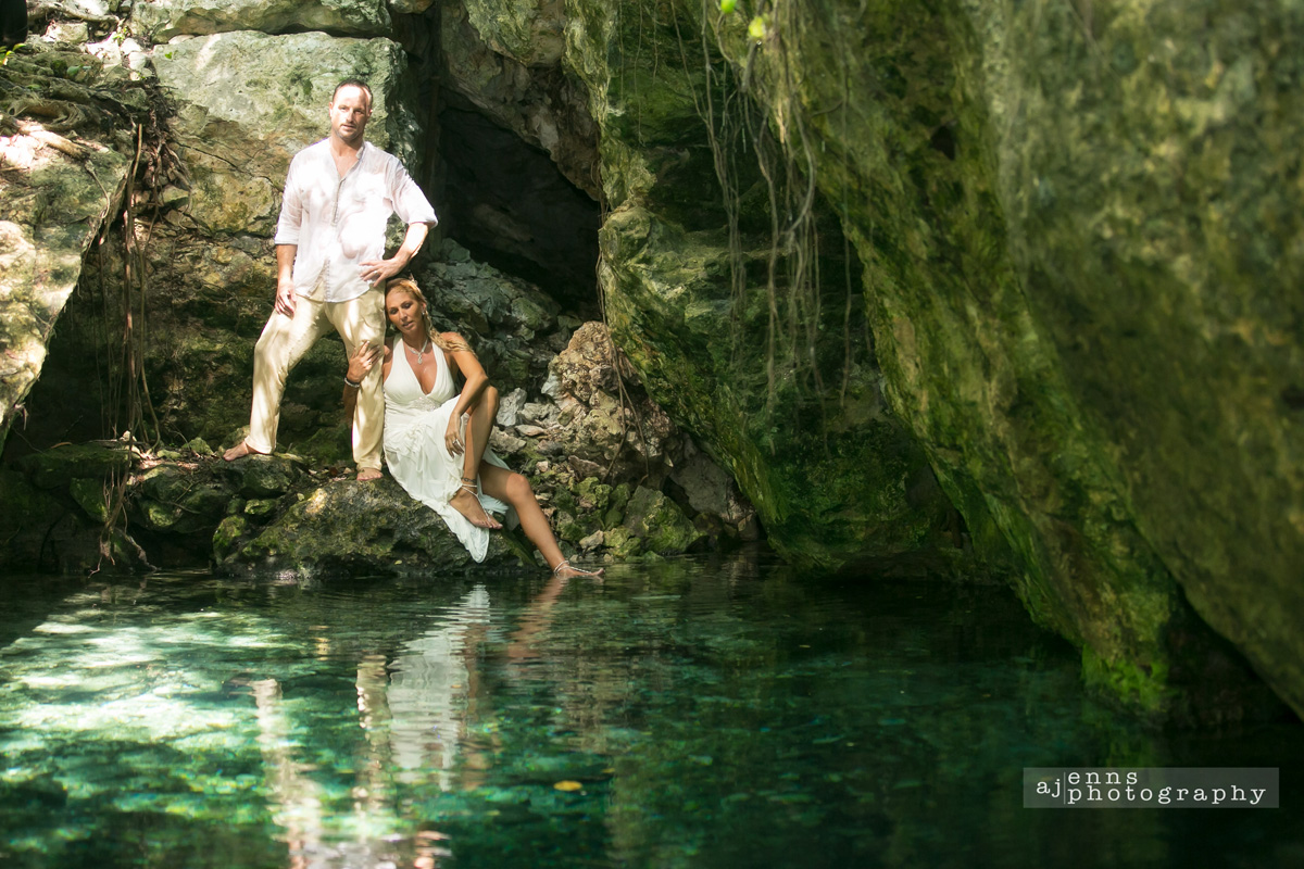 the couple in a cenote Mexico dangling their feet in the water