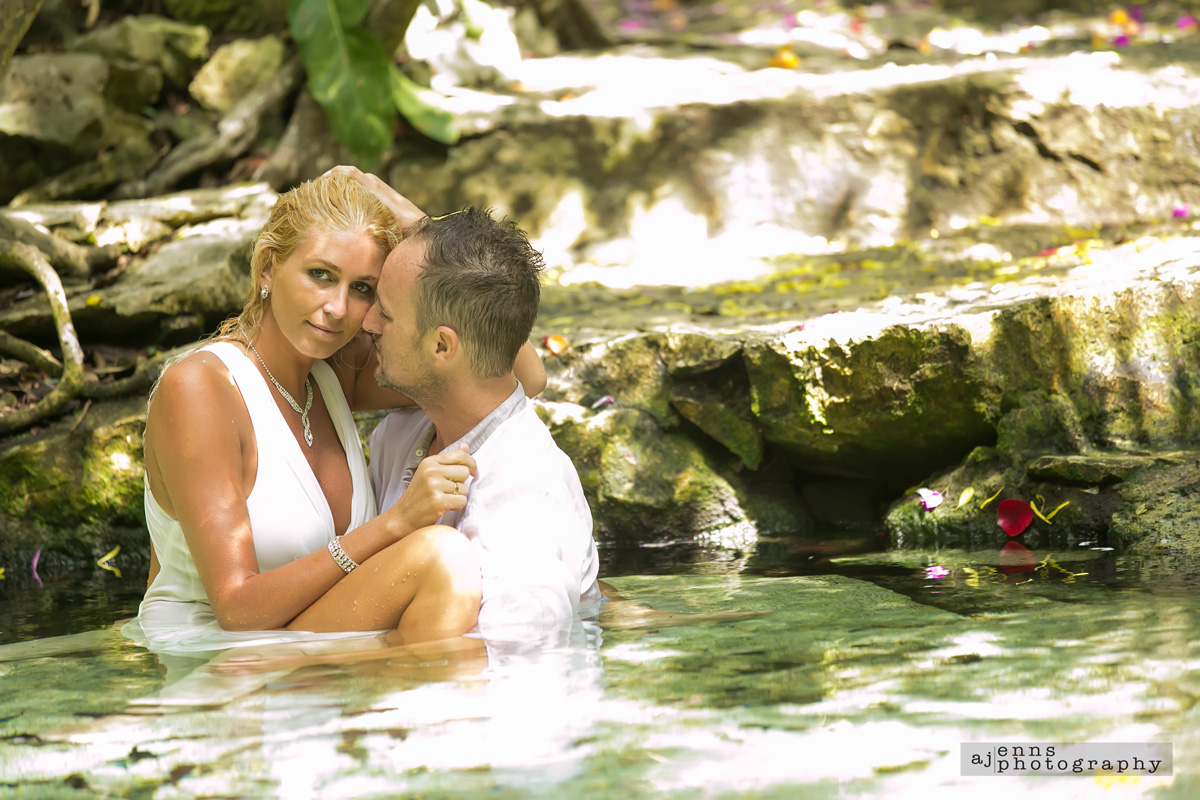 Getting up close and comfy in 2 feet of water with the bride and groom