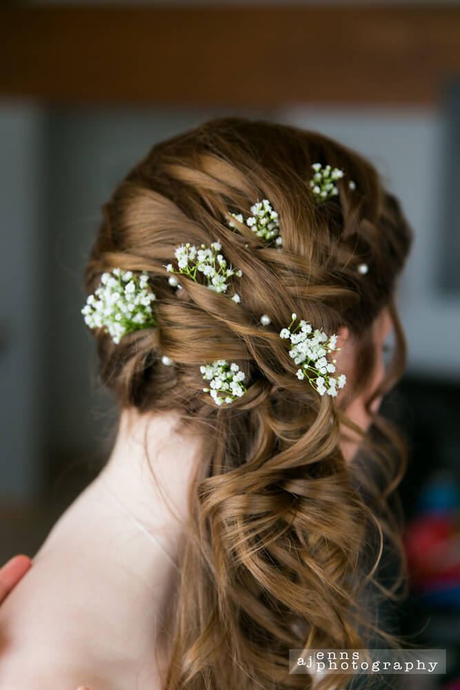 The brides hair ordained with Babies Breath