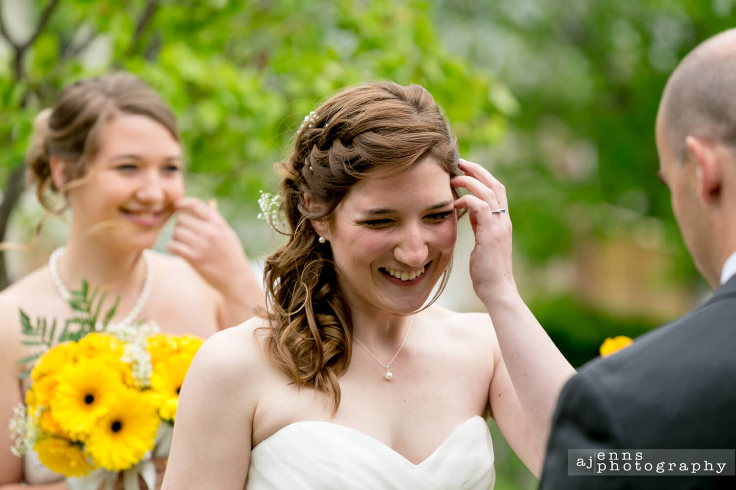 The bride laughing pretty hard during a ceremony joke