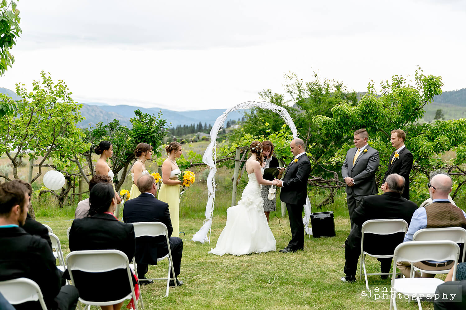 The couple holding hands during the ceremony