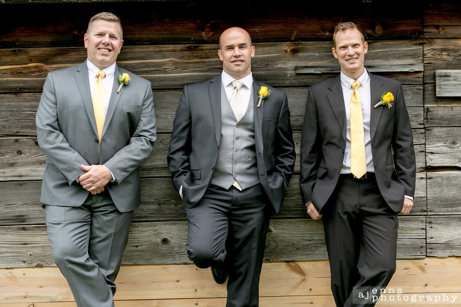 Scott and his boys leaning against a wood wall