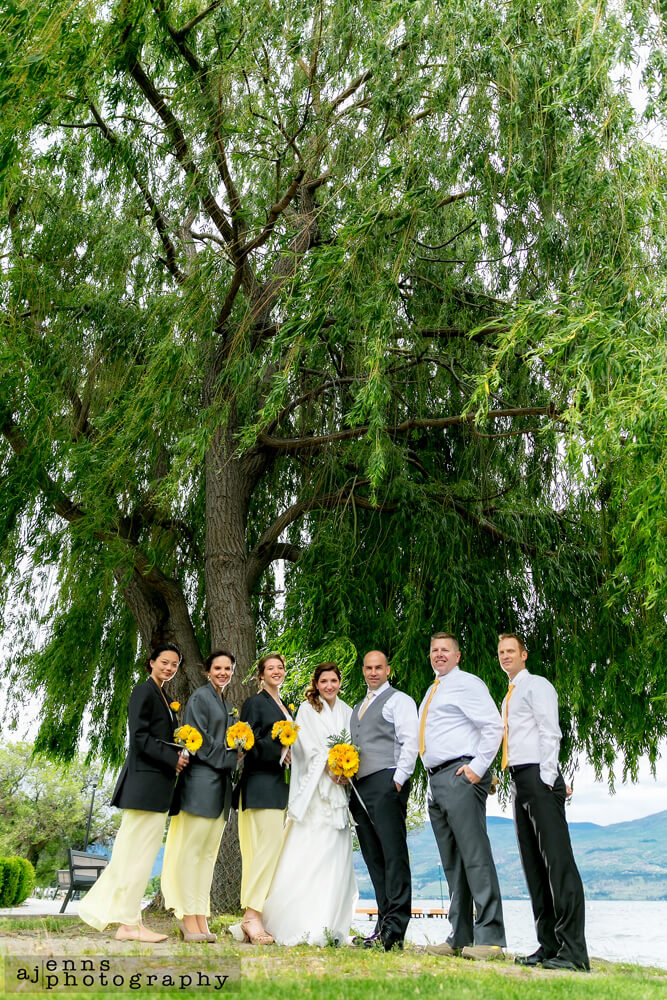 The party standing under a massive willow tree
