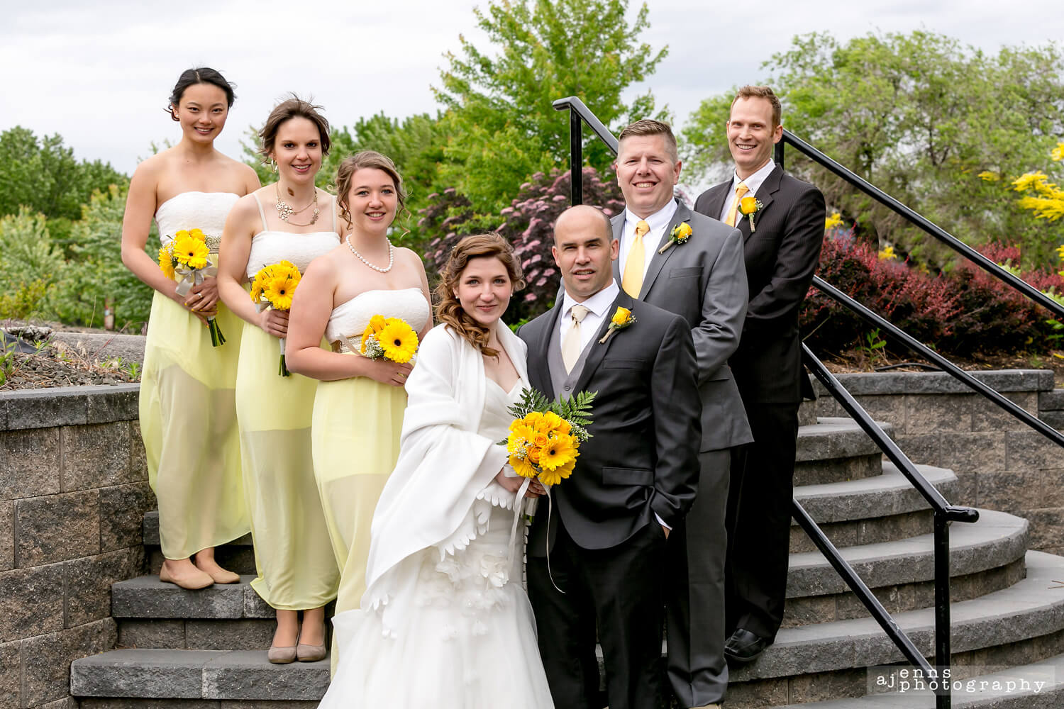 The wedding party standing on the stairs