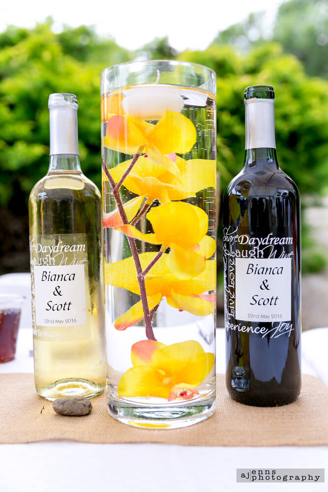 The bride and groom has custom wine made for them