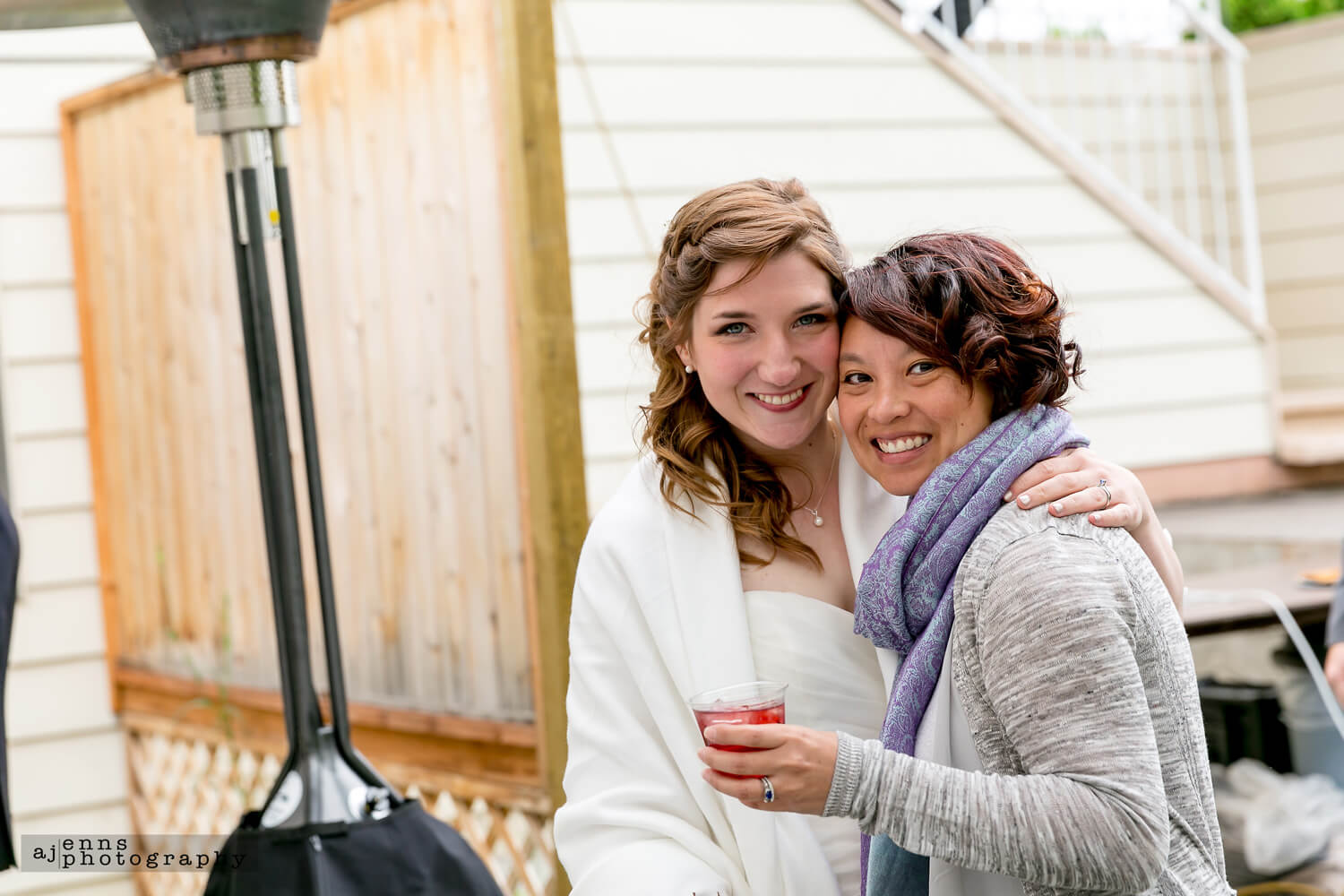 The bride and her friend who gave her a venue for the wedding