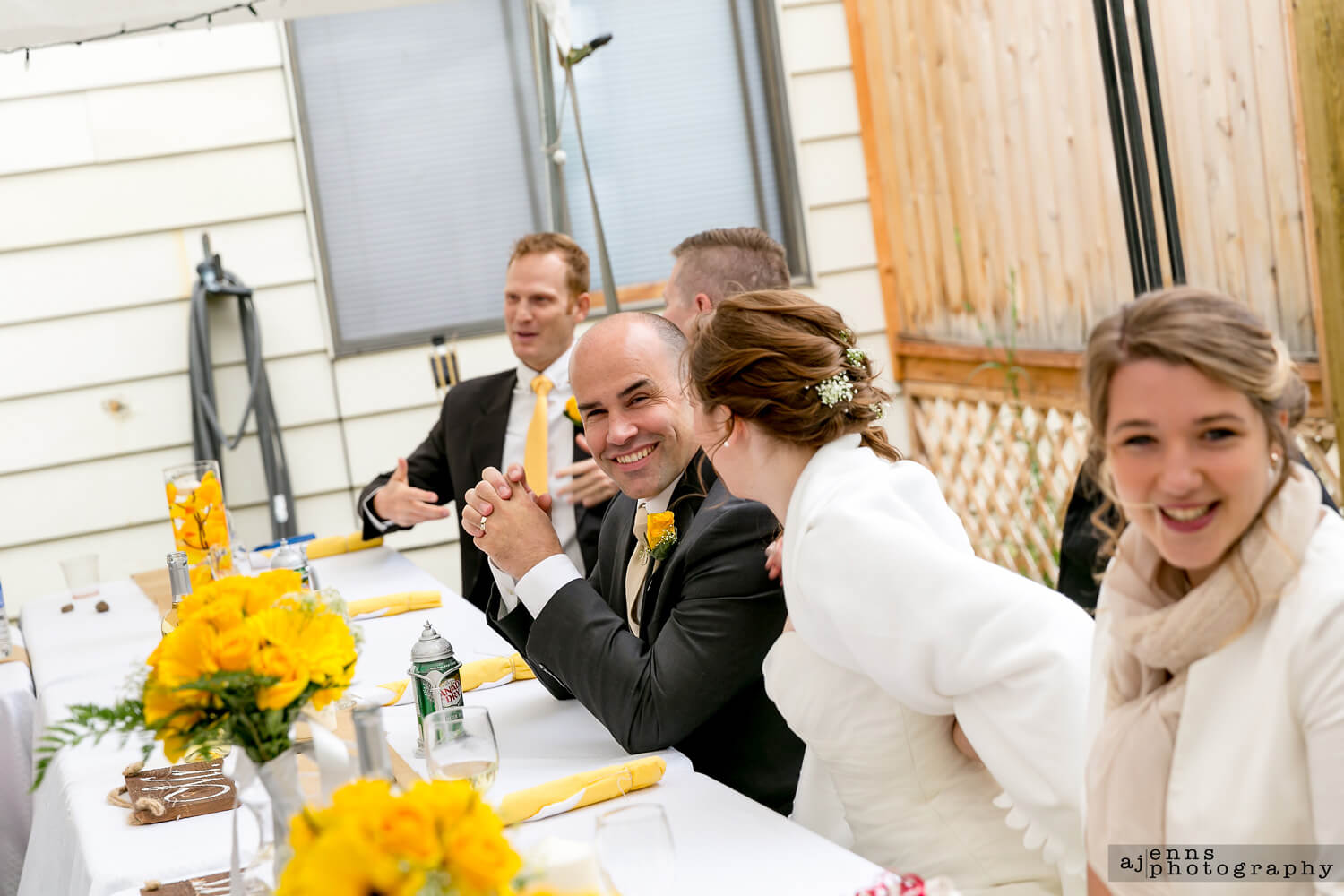 The groom having a laugh from the MC