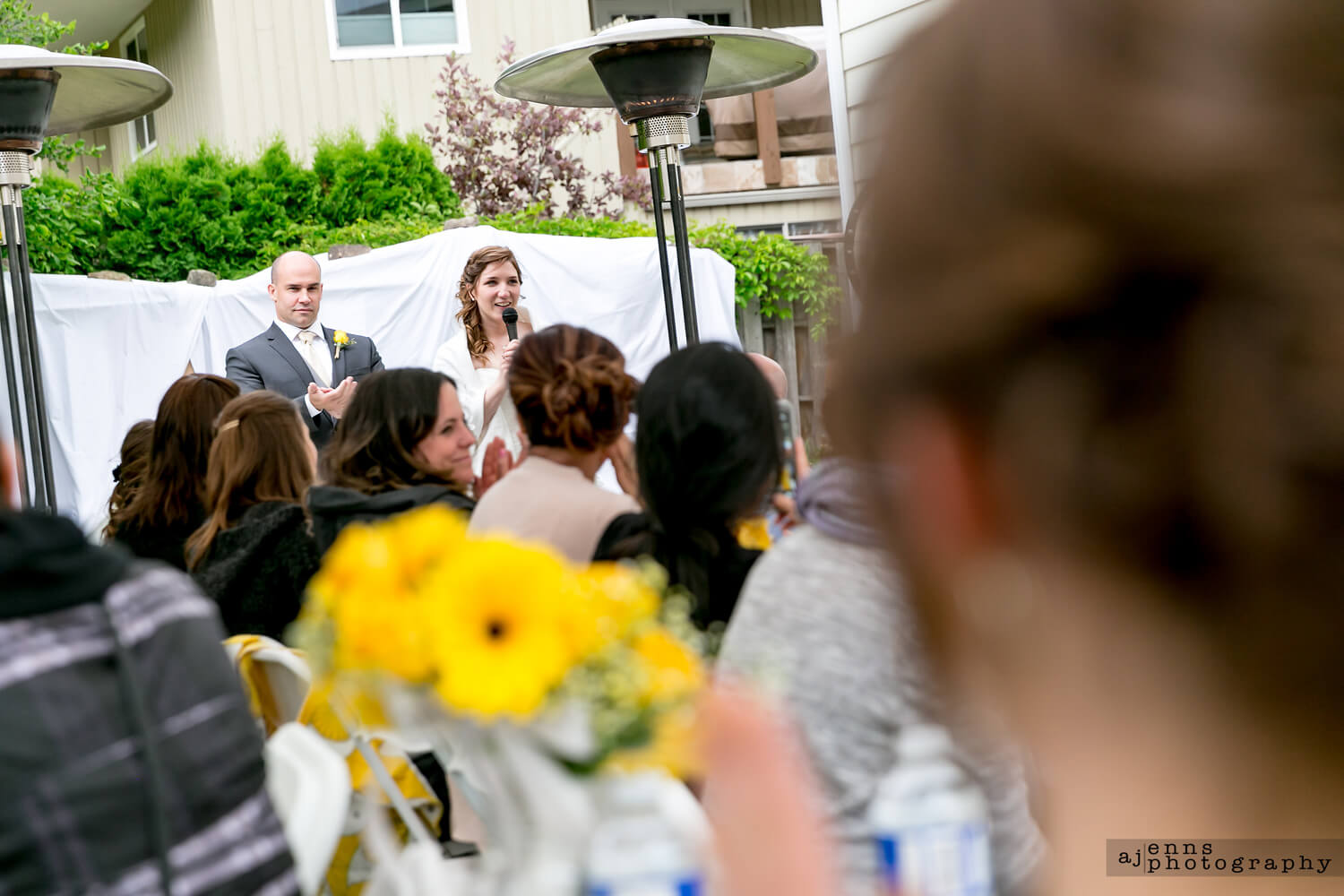 The bride and groom giving their thank you speeches