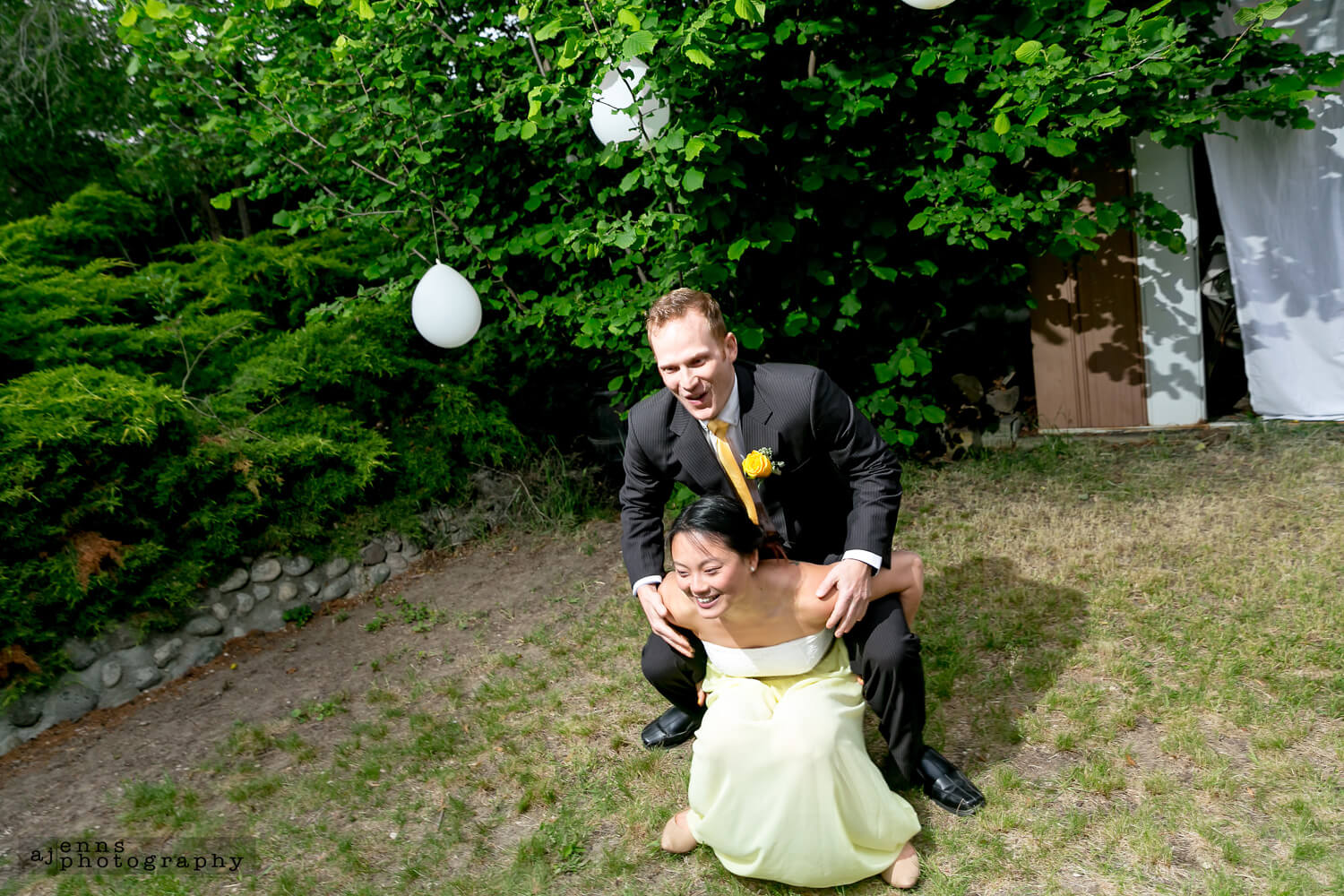 The bridesmaid trying to give a groomsmen a piggy back