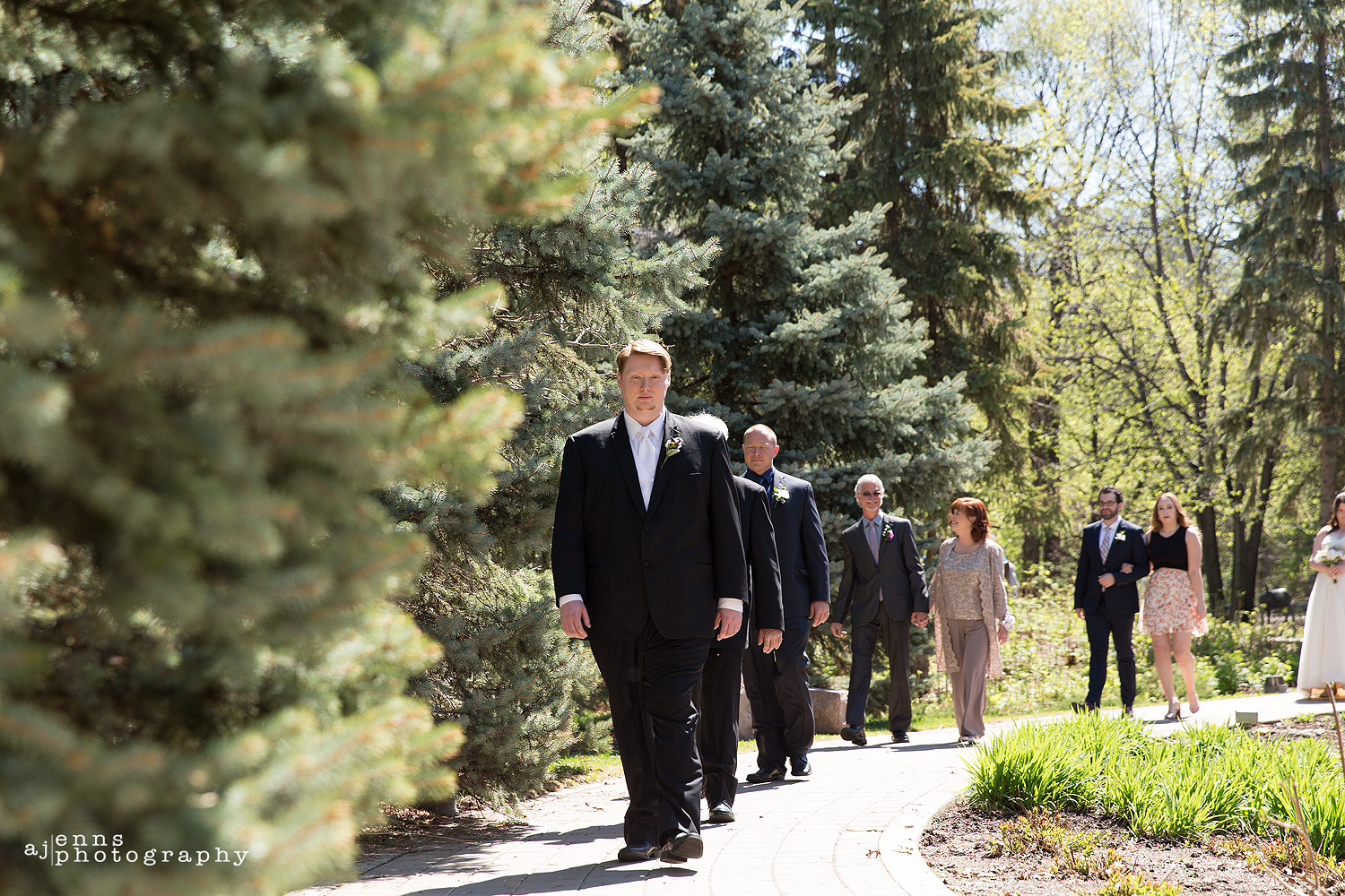 Jeremy walking down the path to the wedding ceremony