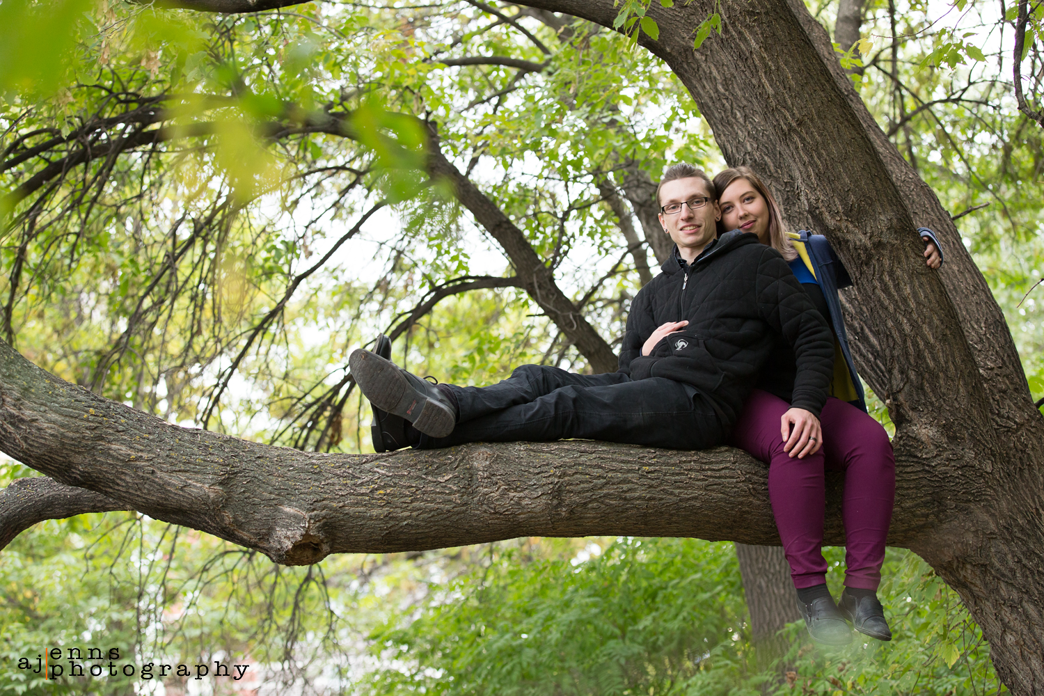 Robyn and Darryl sitting a tree branch