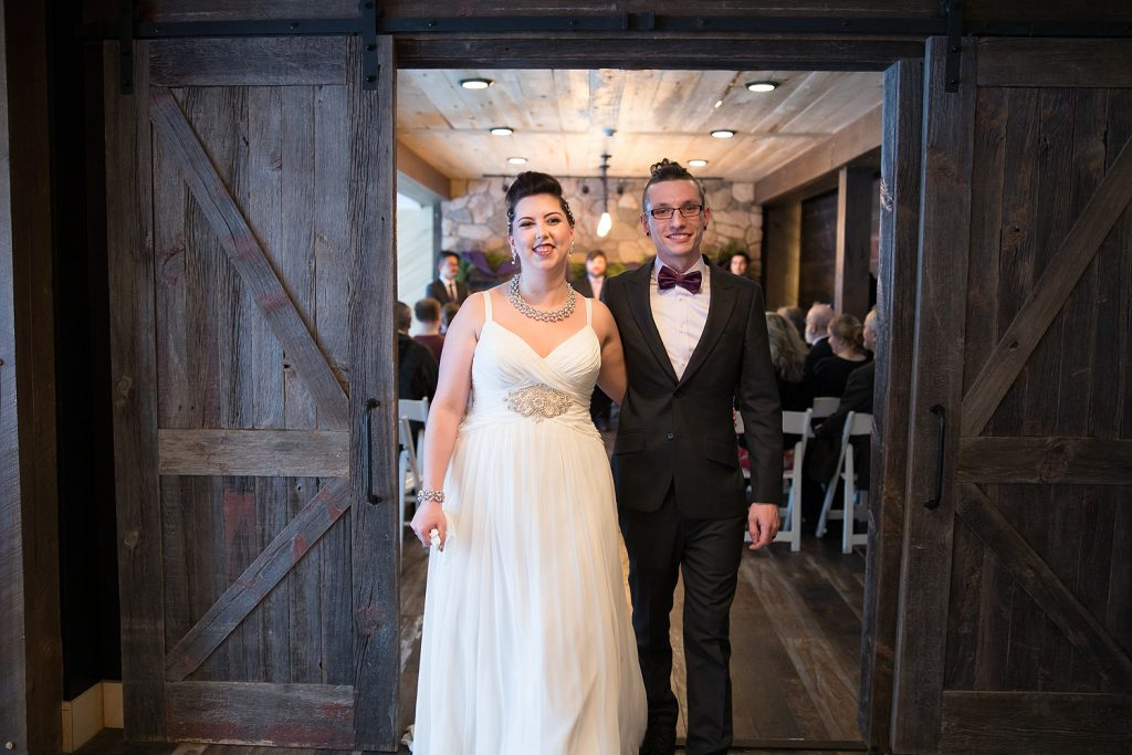 Walking out for the first time as time husband and wife with natural smiles